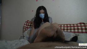 China Girl In Mask Doing Footjob